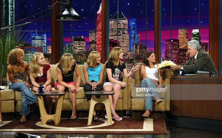 "BURBANK, CA - AUGUST 31: The 2004 US Olympic Women's Gymnastic Team (L - R), Annia Hatch, Courtney McCool, Courtney Kupets, Terin Humphrey, Carly Patterson and team captain Mohini Bhardwaj, appear on ""The Tonight Show with Jay Leno"" at the NBC Studios on August 31, 2004 in Burbank, California. (Photo by Kevin Winter/Getty Images) *** Local Caption *** Annia Hatch;Courtney McCool;Courtney Kupets;Terin Humphrey"